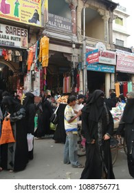 HYDERABAD, INDIA -  NOV 21, 2009 - Veiled muslim women shop in the Lad Bazaar in Hyderabad, India