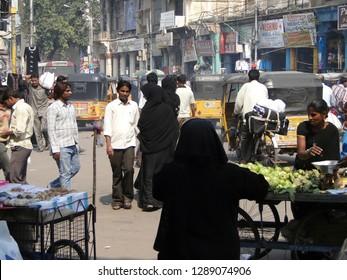 HYDERABAD, INDIA -  NOV 21, 2009 - Veiled muslim women shop in the Lad Bazaar in Hyderabad, India