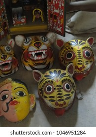 HYDERABAD, INDIA - NOV 23, 2009 -   Colorful tribal masks in folk art garden in Hyderabad, Andhra Pradesh, India, Asia