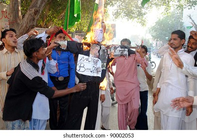 HYDERABAD, PAKISTAN - DEC 02: Supporters of Jamiat Ulema (JUP) burn an effigy as they are protesting against NATO attack in the Country, on December 02, 2011in Hyderabad .