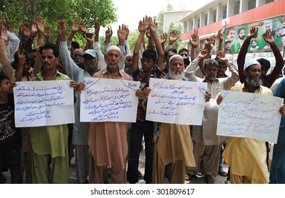 HYDERABAD, PAKISTAN - JUL 31: Residents of Latifabad No. 05 area protesting against land mafia during a demonstration held at press club on July 31, 2015 in Hyderabad.