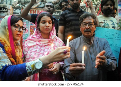 HYDERABAD, PAKISTAN - MAY 13: Activists of Tehreeke Insaf  enlighten candles for soul of Karachis Safora Chowrangi area incident victims during protest demonstration  on May 13, 2015 in Hyderabad.