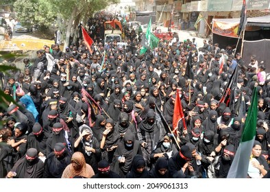 HYDERABAD, PAKISTAN - SEP 28: Shiite mourners of Imam Hussain (A.S) are participating in mourning processions in connection of 40th day Chehlum-e-Hazrat Imam Hussain on September 28, 2021 in Hyderabad
