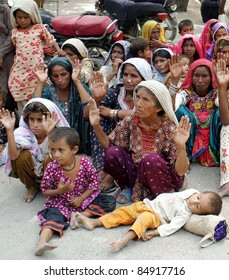 HYDERABAD, PAKISTAN - SEPT 18: Flood affected people protest in favor of their demands during a demonstration at Hyderabad press club on September 18, 2011 in Hyderabad.