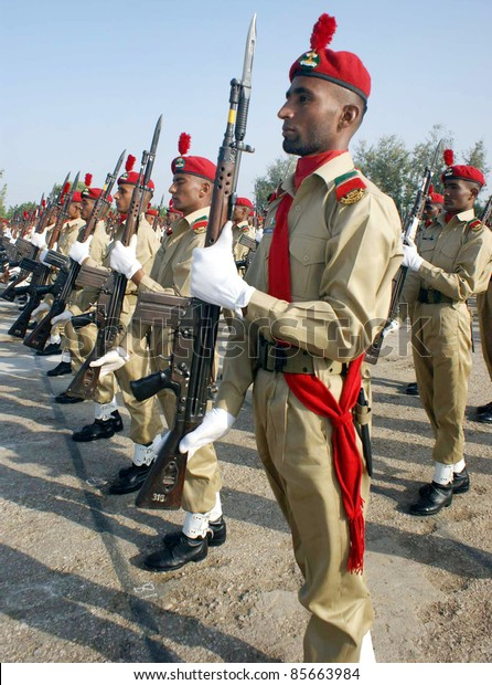 HYDERABAD, PAKISTAN - SEPT 29: Recruits march-past during the passing out parade ceremony held at Sindh Regimental Centre on September 29, 2011in Hyderabad.