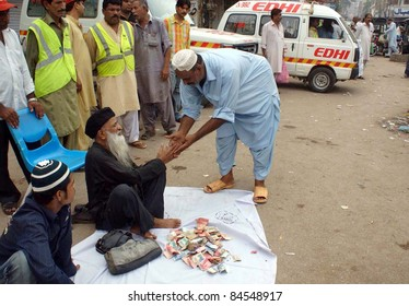 HYDERABAD - SEPT 12: Renowned Social Worker, Abdul Sattar Edhi collects donations for rain affected people at Hyder Chowk in Hyderabad on September 12, 2011.