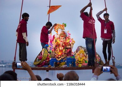 Hyderabad, Telangana / INDIA- 23nd Saturday SEPTEMBER 2018 Devotees carry  idol of Hindu god Ganesh in Hussain Sagar in Crane immersion during Ganesh Chaturthi festival in Hyderabad- Telangana- India.