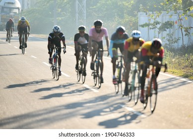 Hyderabad, Telangana  India - December 12,2020, Cyclists riding bikes on a winter morning on Shankarpally Road in Hyderabad