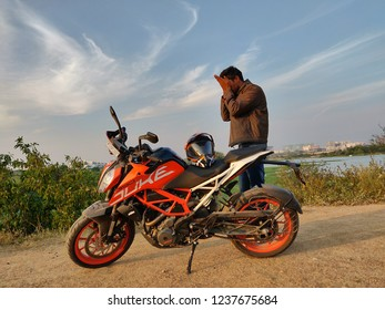 Hyderabad, Telangana, India - November 03, 2018 : Rider person with KTM Duke 390 sports bike in Nature with beautiful sky background