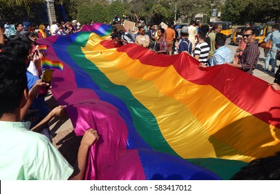 HYDERABAD,FEBRUARY 19: LGBT activists hold a long rainbow colored flag demanding equality during Queer Swabhimana Yatra 2017 on February 19,2017 in Hyderabad,India