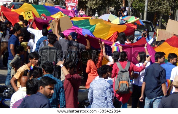 HYDERABAD,FEBRUARY 19:LGBT activists march  holding long rainbow colored flag demanding equality in Queer Swabhimana Yatra 2017 on February 19,2017 in Hyderabad,India