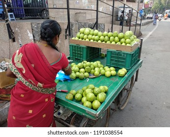 Hyderabad,India. 26th September,2018 Indian woman sells fresh Gauvas on pushcart by a street vendor in India