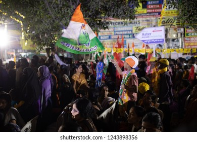 Hyderabad,India.28 November,2018. A young boy waves party flag of Indian National Congress  during a road show of Chief Minister N Chandrababu Naidu and Congress President Rahul Gandhi in Hyderabad