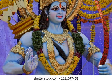 HYDERABAD,INDIA-APRIL 14:Idol of Hindu God Rama, in blessing pose with bow and arrows kept on vehicle lorry to take around in procession on Sri Rama Navami festival on April 14,2019