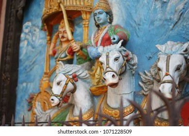 HYDERABAD,INDIA-APRIL 17:wall art of Hindu god Krishna as driver of horse cart and Arjuna as warrior in mahabharat war as in mythology in a temple on April 17,2018 in Hyderabad,India.
