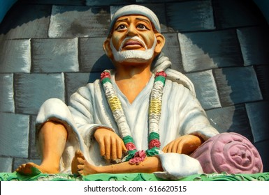 HYDERABAD,INDIA-APRIL 6:Idol of shirdi Sai Baba in sitting posture on the arch of  temple l on April 6,2017 in Hyderabad,India
