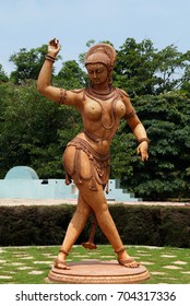 HYDERABAD,INDIA-AUGUST 16:Statue of Indian woman in traditional costume perform classical art style at Ramoji Film city on August 16,2017 in Hyderabad,India