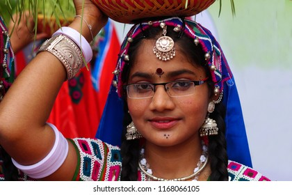 HYDERABAD,INDIA-AUGUST 29: Indian tribal lambadi woman with germinated wheat grass in bamboo basket in Kajal Teej Monsoon Festival on August 29,2018 in Hyderabad