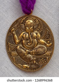 HYDERABAD,INDIA-DECEMBER 23: view of details of Hindu god Ganesha  on locket of Indian woman necklace on December 23,2018 in Hyderabad,India