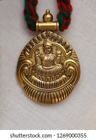 HYDERABAD,INDIA-DECEMBER 23: view of details of Hindu goddess Lakshmi on locket of Indian woman necklace on December 23,2018 in Hyderabad,India