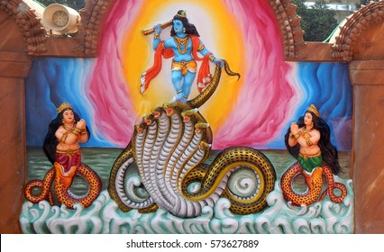 HYDERABAD,INDIA-FEBRUARY 3:Wall art of Sri Krishna dancing on snake kaliya,which came to kill him, as in Mahabharata in Jagannath temple on February 3,2017 in Hyderabad