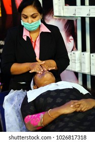 HYDERABAD,INDIA-FEBRUARY 6:Makeup artist does massage of face   and makeup on a young Indian woman on February 6,2018 in Hyderabad,India