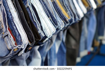 HYDERABAD,INDIA-FEBRUARY 7: Indian man latest fashion clothes jean pants hung on hangers in a retail shop, as display on February 7,2018 in Hyderabad,India