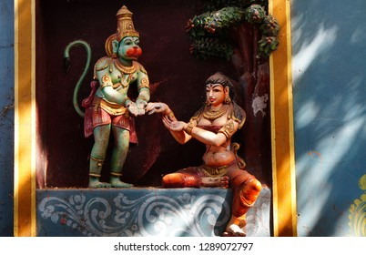 HYDERABAD,INDIA-JANUARY 11:wall art of Indian Hindu god Hanuman  handing over ring of rama to Sita, as in mythology in a temple  on January 11,2019 in Hyderabad,India