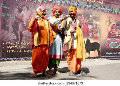 HYDERABAD,INDIA-JANUARY 13:Hindu harikatha singers sing devotional songs going around the community during dhanurmasam before sankranti festival in south India in Hyderabad,India on January 13,2013.
