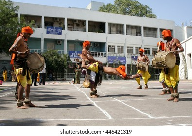 HYDERABAD,INDIA-JANUARY 13;Indian tribal people dance during  Hindu festival pongal celebrations on January 13,2013 in Hyderabad,India