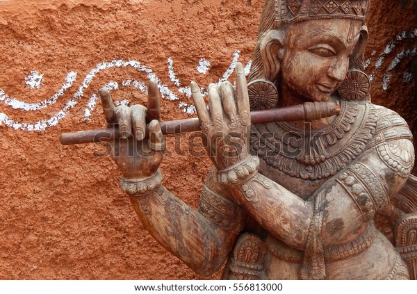 HYDERABAD<INDIA-JANUARY 14:Indian Hindu God Sri Krishna wooden carving,playing Flute,worship  is part of Vaishnavism, incarnation of Lord Vishnu on January,14,2017 in Hyderabad,India.