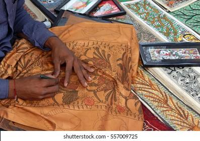 HYDERABAD,INDIA-JANUARY 14:Indian Hindu madhubani printing or mithila painting artist work on textile on January 14,2017 in Hyderabad,India.