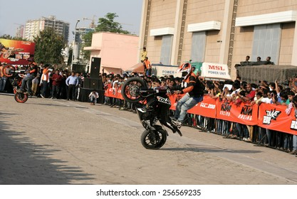 HYDERABAD,INDIA-JANUARY 1:Motor cyclists KTM bikers perform stunts during the Hyderabad international auto expo on january 1,2000 in Hyderabad,India.