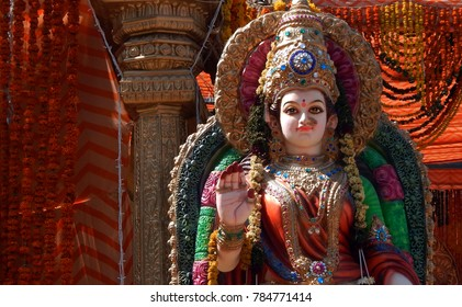 HYDERABAD,INDIA-JANUARY 1:Statue of Hindu goddess lakshmi in blessing pose ,decorated with flowers, in a temple  on January 1,2018 in Hyderabad,India.