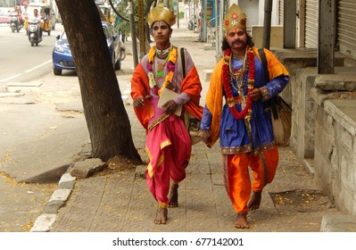 HYDERABAD,INDIA-JULY 09:Hindu men with make up as mythological characters walking to Mahankali temple on Bonalu festival on July 09,2017 in Hyderabad,India