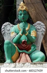 HYDERABAD,INDIA-JULY 23:Statue of Hindu God Garuda a bird avatar in mythology in Ramayana on temple top on July 23,2017 in Hyderabad,India