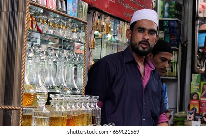 HYDERABAD,INDIA-JUNE 01:Indian street side vendor sell attar or perfume, in the busy market of old city, Popular and traditional accessory on June 01,2017 in Hyderabad,India