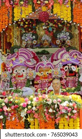 HYDERABAD,INDIA-JUNE 24:Hindu god Jagannath,balabhadra and Subhadra idols on chariot for rath yatra in the streets and  devotees pull the rath on June 24,2017 in Hyderabad,India