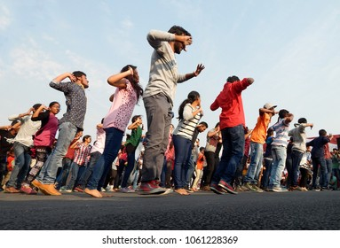 HYDERABAD,INDIA-MARCH 27:People dance on road on Sunday morning up to 9 AM ,which are kept for open roads program with out vehicular  traffic on March 27,2016 in Hyderabad