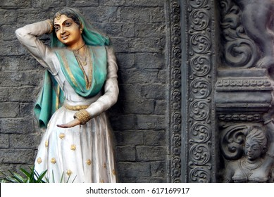 HYDERABAD,INDIA-MARCH 30:wall art of an Indian kathak dancer traditionally dressed and dancing on a pillar of flyover on March 30,2017 in Hyderabad,India