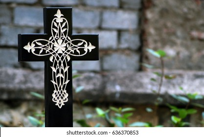 HYDERABAD,INDIA-MAY 5:Holy cross Headstone or Tombstone with floral design engraved  in Christian cemetery in Narayanaguda on May 3,2017 in Hyderabad,India.