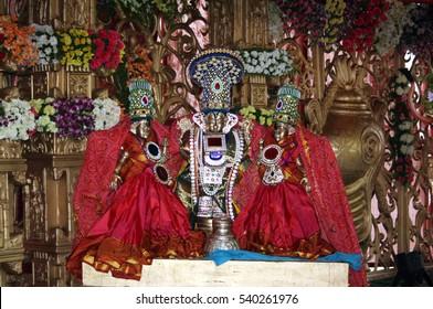 HYDERABAD,INDIA-NOVEMBER 26:People offer prayers to Idol of Hindu God Balaji  with consorts or venkateswara on November 26,2012 in Hyderabad,India