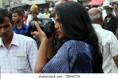 HYDERABAD,INDIA-OCTOBER 1:Indian Woman Photographer shoot with DSLR,Shiite Muslims flagellate themselves in a procession to mark Ashoura during muharram on October 1,2017 in Hyderabad,India.