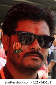 HYDERABAD,INDIA-OCTOBER 28 :Portrait of Indian man with face painted with  Lotus flower symbol of ruling  BJP party in a  convention  on October 28,2018 in Hyderabad,India.