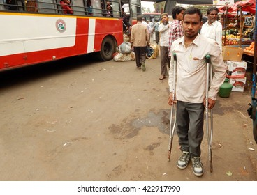 HYDERABAD,MAY 19:Indian handicapped or physically challenged young man wait for bus in a bus terminal on May 19,2016 in Hyderabad,India.