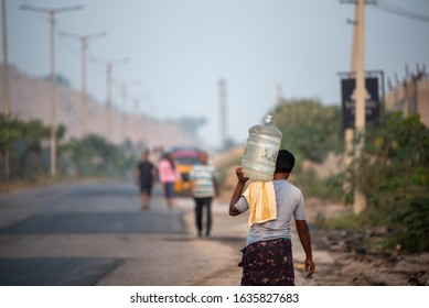 Hyderabad,Telangana,India, November 20, 2019, an Indian man carries water in a plastic can in Kaithalapur,Hyderabad as they face serious water scarcity