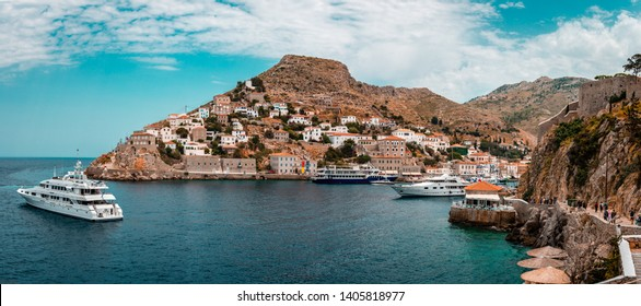Hydra / Greece - April 29 2018: A luxurious yacht leaves the island. Hydra is one of the Saronic Islands, located in the Aegean Sea, between the Saronic Gulf and the Argolic Gulf.