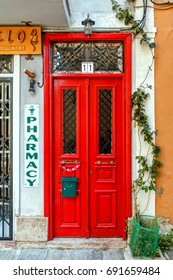HYDRA, GREECE - MAY 10, 2017: pharmacy front with red door