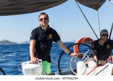 HYDRA, GREECE - SEP 28, 2016: Sailors participate in sailing regatta 16th Ellada Autumn 2016 among Greek island group in the Aegean Sea, in Cyclades and Saronic Gulf.