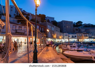 Hydra, Greek Island - July 20 2019; Town and waterfront at night as tourists move about enjoying life and the atmosphere on Greek island